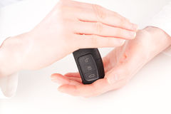Insurance - hands protecting a car key Stock Image