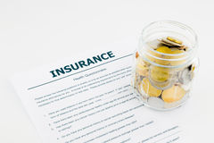 Insurance health questionnaire and coins. On white background Royalty Free Stock Images