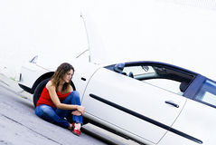 Insurance help. Woman waits for car insurance  mechanic Royalty Free Stock Image