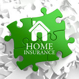 Insurance - Home Icon on Green Puzzle. Stock Photo