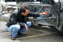 Insurance inspector. Inspector assessing the car damages royalty free stock photography