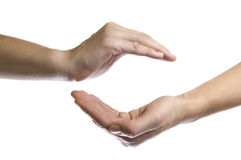 Insurance. Isolated image of two hands facing each other as a symbol of protection and insurance Stock Photography