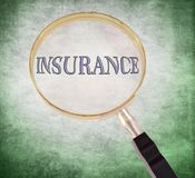 Insurance magnify. By 3d rendered magnifying glass on green grunge background Stock Images