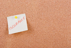Insurance. Note pinned to cork board Royalty Free Stock Images