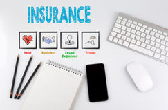 Insurance. Office desk table with computer, Smartphone, note pad, pencils Royalty Free Stock Images