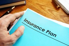 Insurance Plan policy papers on desk. stock image