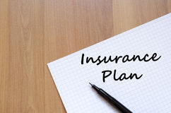Insurance plan write on notebook. Insurance plan text concept write on notebook with pen Royalty Free Stock Image