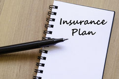Insurance plan write on notebook. Insurance plan text concept write on notebook with pen Royalty Free Stock Photos
