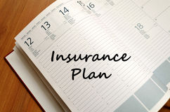 Insurance plan write on notebook. Insurance plan text concept write on notebook with pen Stock Image