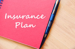 Insurance plan write on notebook. Insurance plan text concept write on notebook with pen Stock Photos