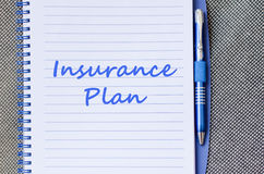 Insurance plan write on notebook. Insurance plan text concept write on notebook with pen Stock Photography