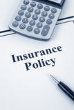 Insurance Policy. Document of Insurance Policy and calculator,  for background Stock Photo