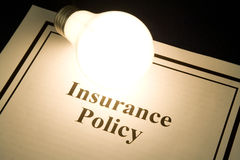 Insurance policy. And light bulb, concept of smart in business Royalty Free Stock Images