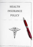 Insurance policy. Health insurance policy with pen Stock Photo