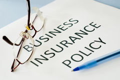 Insurance policy. On blue background Royalty Free Stock Images