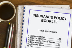 Insurance Policy. Booklet  with coffee and documents concept Stock Photo