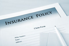 Insurance Policy and Claim Form Stock Photos