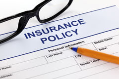 Insurance policy. Form with glasses and ballpoint pen Stock Images