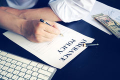 Insurance policy. Man is signing up an insurance policy Royalty Free Stock Photography
