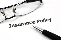Insurance policy. With pen on white Stock Image