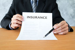 Insurance policy and policyholder must to sign. Stock Image