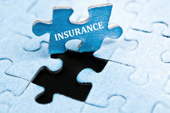 Insurance puzzle Stock Photo