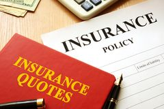 Insurance quotes book and policy. Royalty Free Stock Image