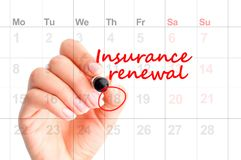 Insurance renewal reminder in calendar handwritten. By woman hand Stock Photos