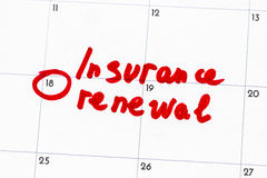 `insurance renewal ` is the text written on the calendar in red marker.  Royalty Free Stock Photos