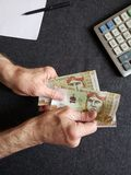 Hand of an older man holding a peruvian banknote. Insurance with retirement and protection plan, investment for monthly pensions to adulthood, need of economic stock photos