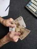 Hands of an older man counting russian banknotes. Insurance with retirement and protection plan, investment for monthly pensions to adulthood, need of economic stock photos