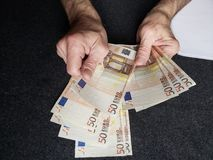 Hands of an older man counting european banknotes. Insurance with retirement and protection plan, investment for monthly pensions to adulthood, need of economic royalty free stock image