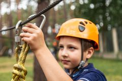 The boy insures his life. Insurance on a rope town, safety of life and health royalty free stock images