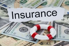 Insurance text on piece of paper with banknotes Stock Photos