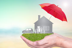 Insurance to protection by umbrella Stock Image