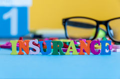 Insurance - word composed of small colored letters on business workplace of broker. Illustration of the concept of Royalty Free Stock Images