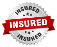 Insured badge. Insured round badge with ribbon Stock Photography