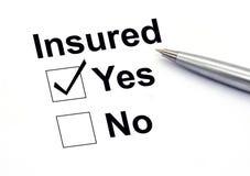 Insured yes check-box. Closeup Royalty Free Stock Photo