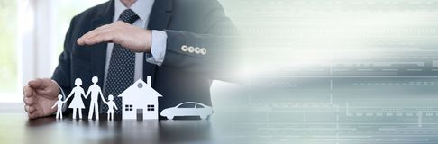 Concept of family, home and car insurance. panoramic banner. Insurer protecting a family, a house and a car with his hands. panoramic banner stock image