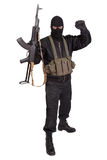 Insurgent in black uniform and mask with kalashnikov Royalty Free Stock Photo