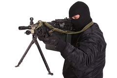 Insurgent in black uniform and mask with machine gun Royalty Free Stock Photo