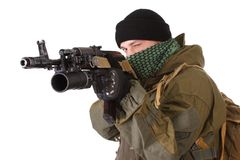 Insurgent with kalashnikov rifle with under-barrel grenade launcher Royalty Free Stock Image