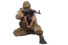 Insurgent wearing keffiyeh with AK 47 gun. Isolated on white Royalty Free Stock Photos