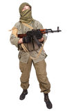 Insurgent wearing keffiyeh with AK 47 gun. Isolated on white Stock Images