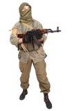 Insurgent wearing keffiyeh with AK 47 gun Stock Images