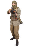 Insurgent wearing keffiyeh with AK 47 gun. Isolated on white Royalty Free Stock Photography