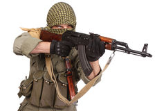 Insurgent wearing keffiyeh with AK 47 gun. Isolated on white Royalty Free Stock Images