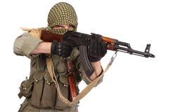 Insurgent wearing keffiyeh with AK 47 gun Royalty Free Stock Images