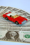 Insuring your car. Paying hard cash to get your car insured Stock Photo