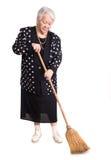 Intégral de la maison de nettoyage de femme agée avec le balai Photos libres de droits